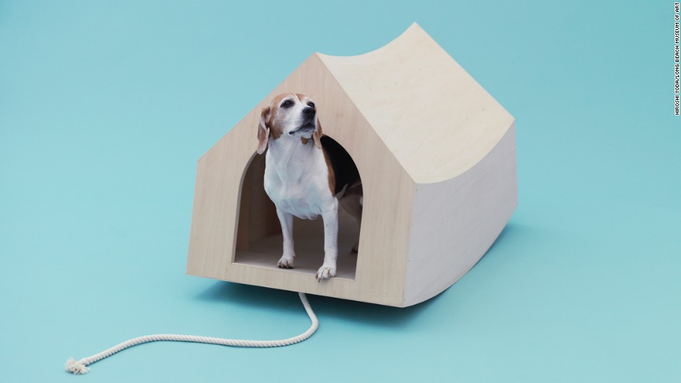 "The Dutch architecture firm MVRDV's ""Beagle House: Interactive Dog House"" is a rocking wooden house with a rope for chewing -- details the tireless beagle is sure to appreciate."