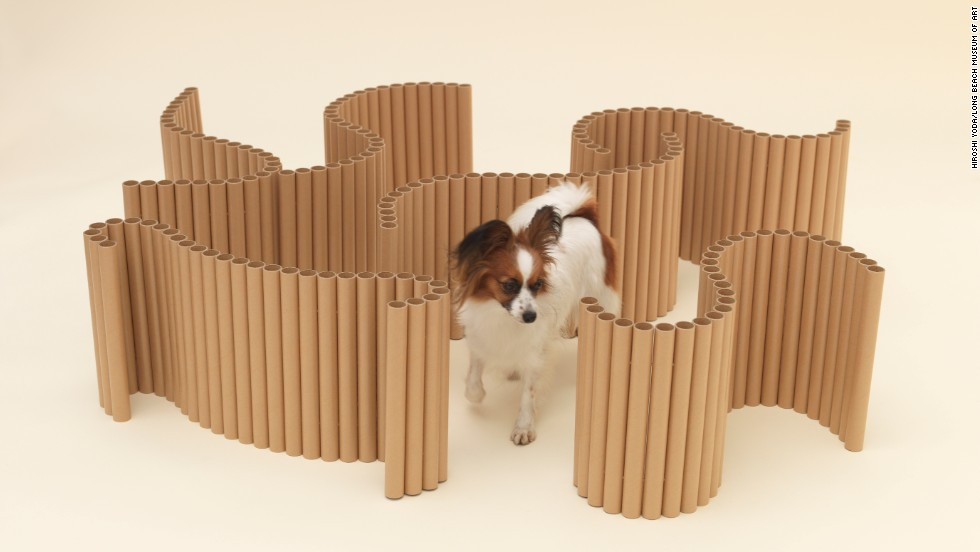 "Shigeru Ban designed ""Papier Papillon,""  a series of strung-together cardboard tubes that can be molded into a maze, a chair, a swing, a pen, even a coffee table."