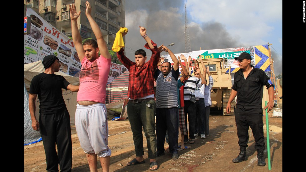 Egyptian security forces detain protesters in Cairo's Nasr City district on August 14, 2013.