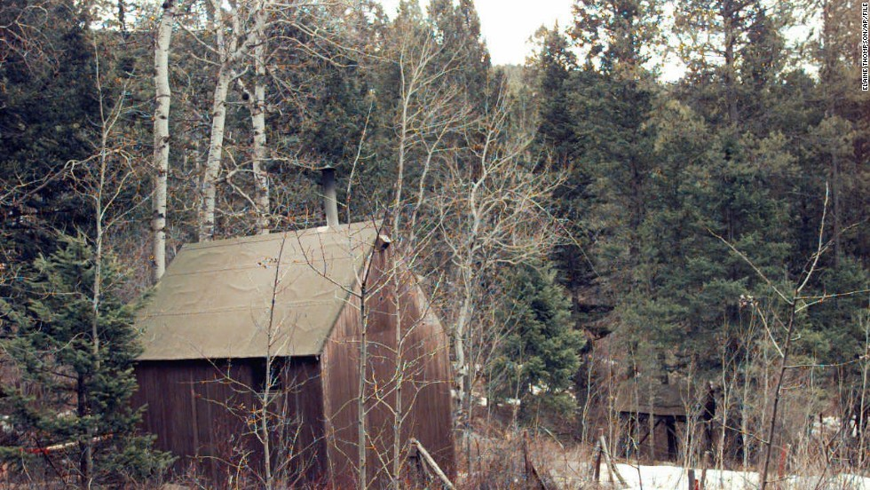 White plastic tape surrounds Kaczynski's cabin, hidden in a wooded area about 300 yards from the nearest neighbor in Lincoln, Montana, in April 1996. The cabin was put on display at the Newseum in Washington in 2008.