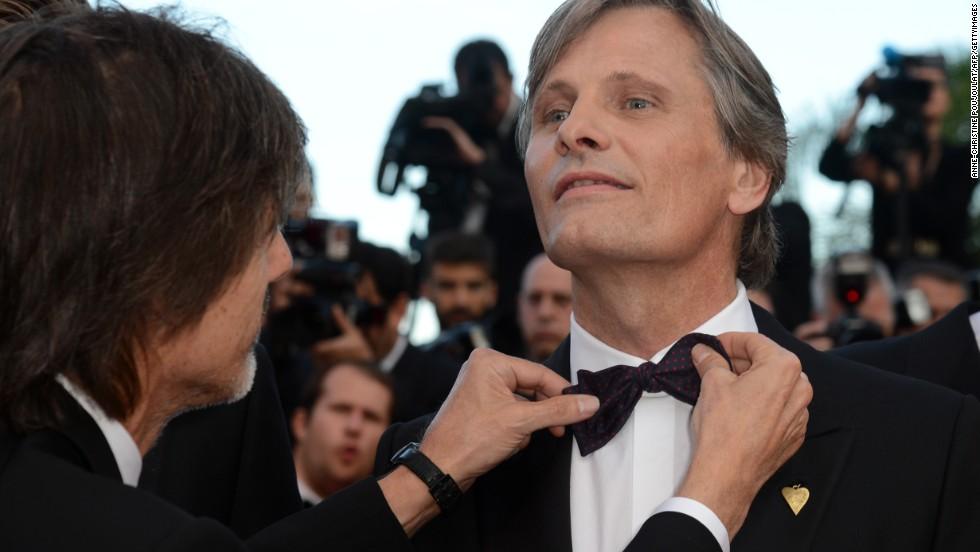 Brazilian director Walter Salles, left, adjusts Viggo Mortensen's bow tie at the 65th Cannes film festival in May 2012. Moretensen is 56.