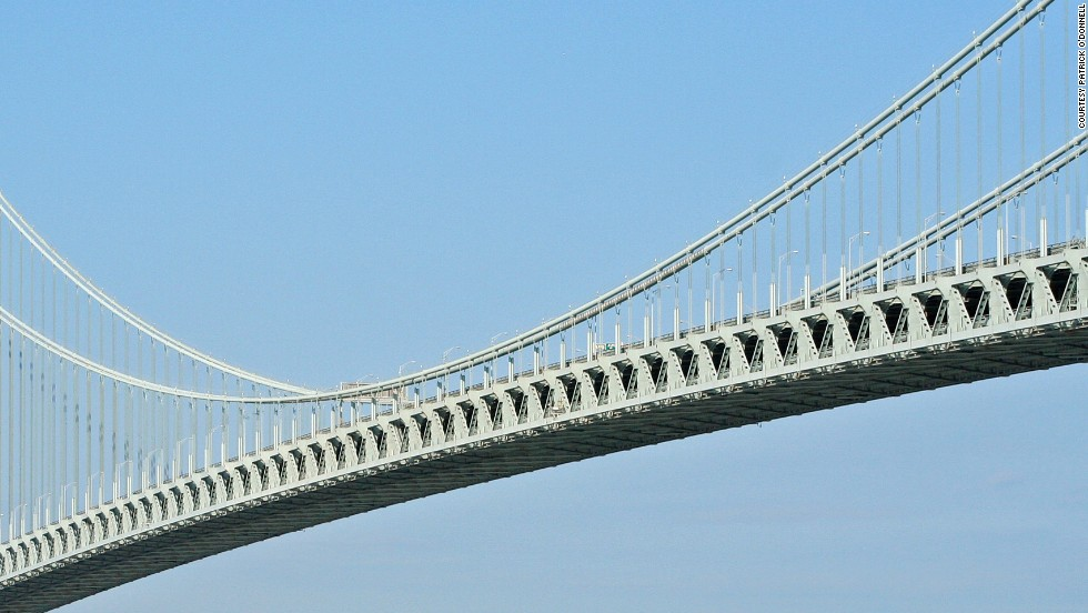 "The Verrazano-Narrows Bridge, <a href=""http://www.fhwa.dot.gov/highwayhistory/resultsDisplayImg.cfm?callPage=&img=ny_3_verrazanonarowsbridge_FHWA_1964_615.jpg&results="" target=""_blank"">according to the U.S. government</a>, is suspended 228 feet (69 meters) above the water between Brooklyn and Staten Island. <a href=""http://www.fhwa.dot.gov/highwayhistory/resultsDisplayImg.cfm?callPage=&img=ny_3_verrazanonarowsbridge_FHWA_1964_615.jpg&results="" target=""_blank""> </a>"