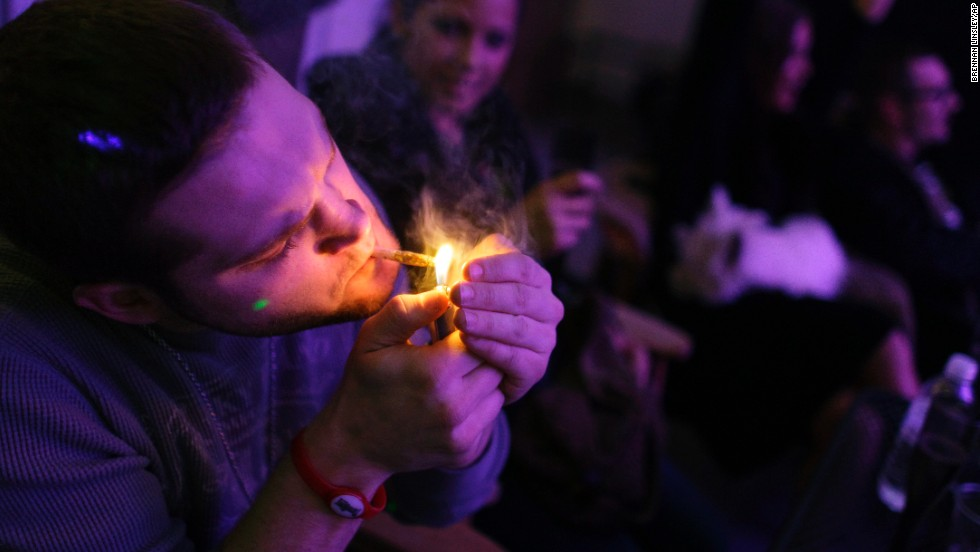 "A man smokes a joint during the official opening night of Club 64, a marijuana social club in Denver, on New Year's Eve 2012. Voters in <a href=""http://www.cnn.com/2012/11/07/politics/marijuana-legalization/index.html"">Colorado and Washington state</a> passed referendums to legalize recreational marijuana on November 6, 2012."