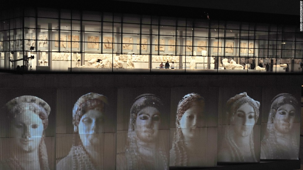 The genius of Ancient Greek classicism is nowhere better expressed than in the Parthenon sculptures in the Acropolis Museum. Here female sculptures are projected on the Athens building.