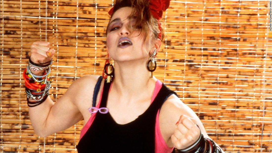 Madonna's look in 1984: layered tops, dark makeup and bracelets, bracelets and more bracelets.