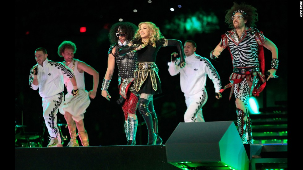 LMFAO and Madonna take the field during the halftime show of Super Bowl XLVI in Indianapolis, Indiana, on February 5, 2012.