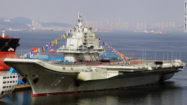China's military turns to the stock market to help propel naval expansion. Pictured above, the Liaoning, China's first aircraft carrier.
