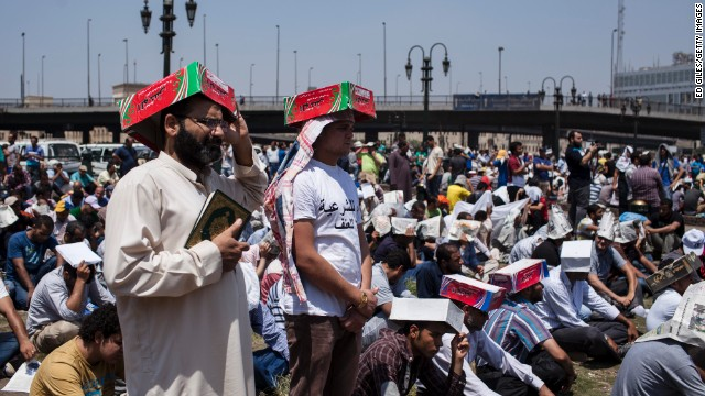 CAIRO, EGYPT - AUGUST 16: Supporters of deposed Egyptian President Mohammed Morsi gather at the Fateh Mosque in Ramses Square for midday prayer on August 16, 2013 in Cairo, Egypt. The Egyptian Military has closed off the city's iconic Tahrir Square today to pedestrian traffic in response to calls for mass protests in downtown Cairo after midday prayer. Hundreds of pro-Morsi protesters were killed in Egypt's capital on August 14 as Egyptian Security Forces undertook a planned operation to clear Morsi supporters from two sit-in demonstrations in Cairo where they have camped for over one month. Egyptian Police and Army forces entered protest sites in the Nasr City and Giza districts at dawn on August 14, using tear gas, live fire and bulldozers to disperse protesters and destroy the camps. (Photo by Ed Giles/Getty Images)