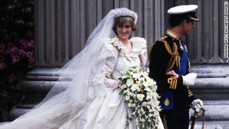 Diana and Charles are wed on July 29, 1981.  Here the prince and princess, clad in an emanuel wedding dress, leave St. Paul's Cathedral.