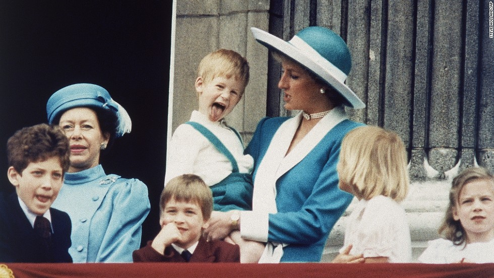Prince Harry shows a bit of his personality, which doesn't appear to please his mother, on June 11, 1988, on the balcony of Buckingham Palace.