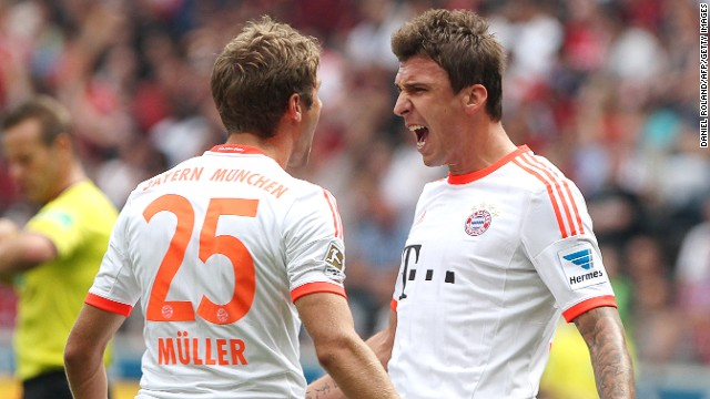 Mario Mandzukic (right) celebrates scoring Bayern Munich's winner against Frankfurt on Saturday.