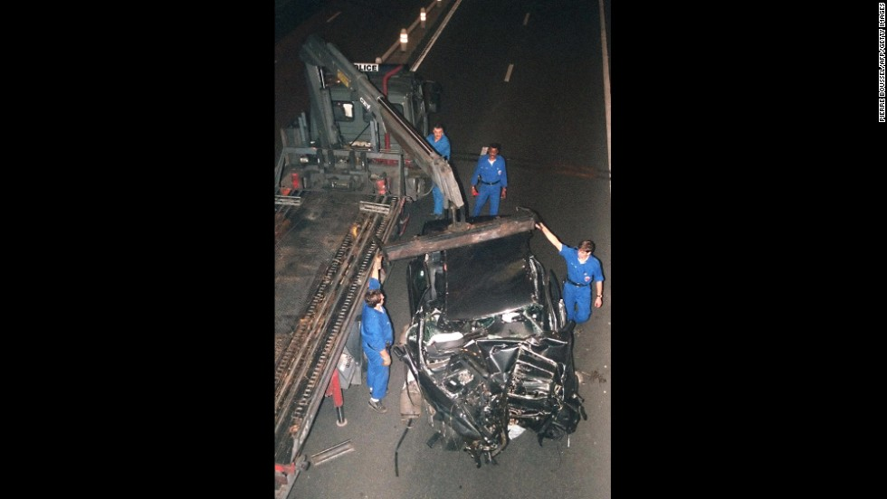 The wreckage of the car is prepared to be moved after the crash.