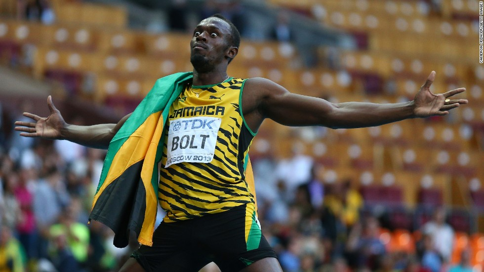 Usain Bolt celebrates after claiming his third 200m world title on Saturday.
