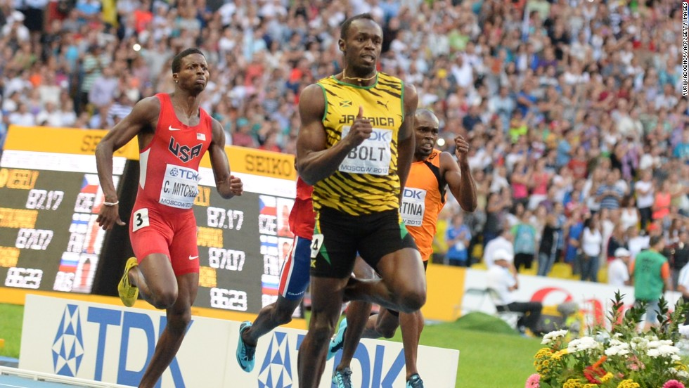 Usain Bolt powers ahead of the field in the 200m final in Moscow. Compatriot Warren Weir took the silver and Curtis Mitchell (left) of the U.S. took bronze.
