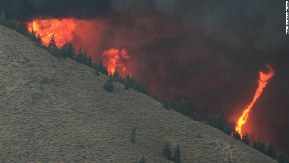 "A fire ""whirl"" can be seen as erratic wind conditions stir the flames of the fire on August 16."