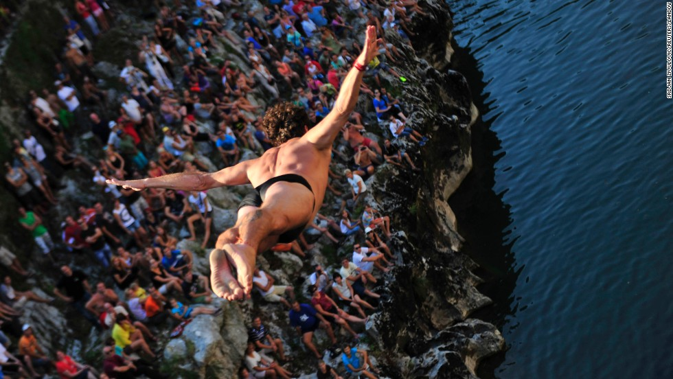A diver jumps off a bridge into the Soca River on Sunday, August 18, during a traditional jumping competition in Kanal ob Soci, Slovenia.