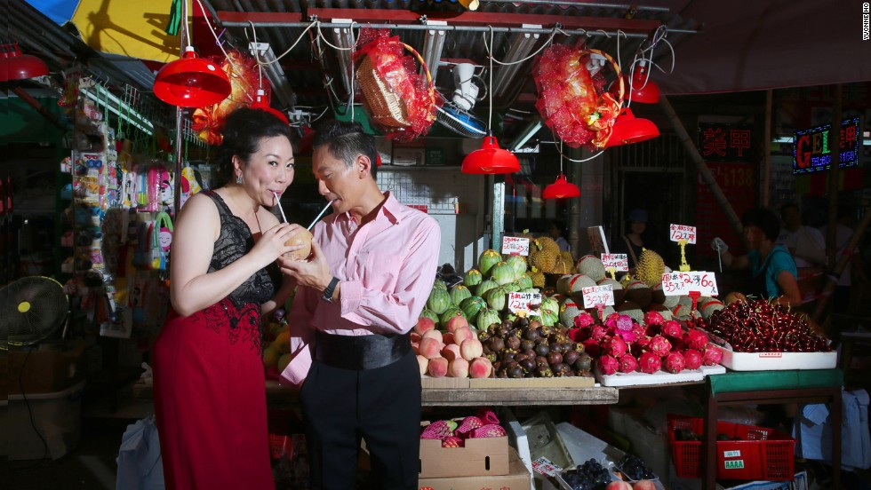 In another shot, the couple pose near a fruit stall in Hong Kong.