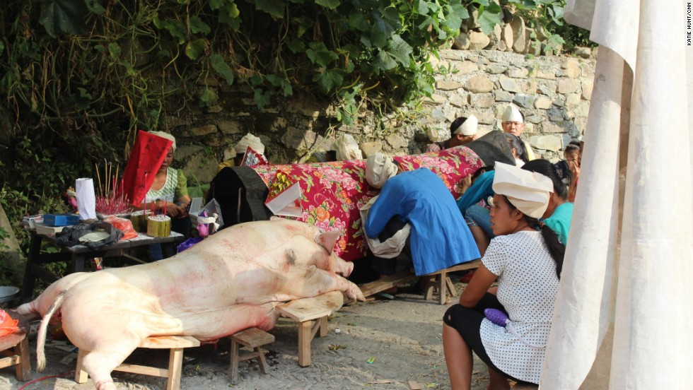 Traditional practices are still observed. After the death of a village elder, female family members wearing white headscarves sit wailing by the coffin wailing and a sacrificed pig.