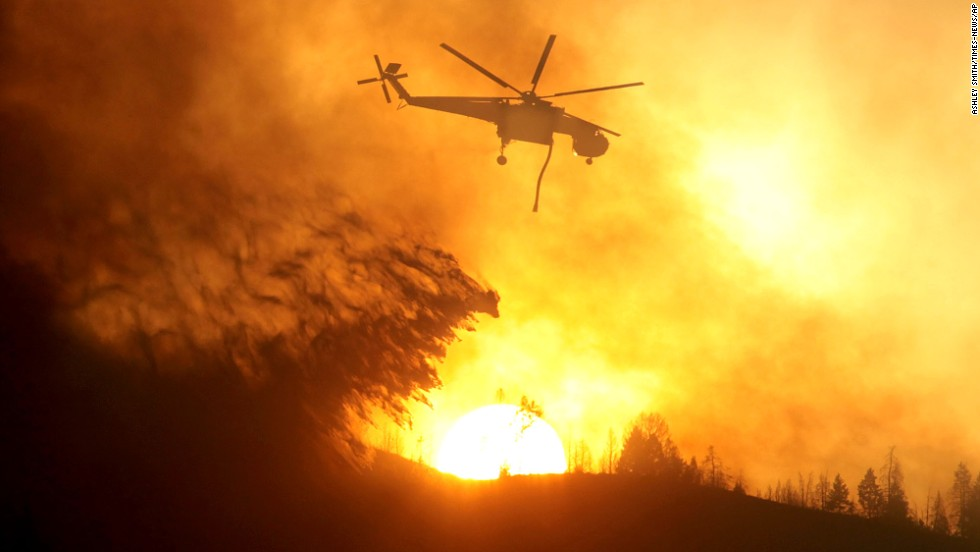 A helicopter makes a drop while battling the Beaver Creek Fire on August 17.