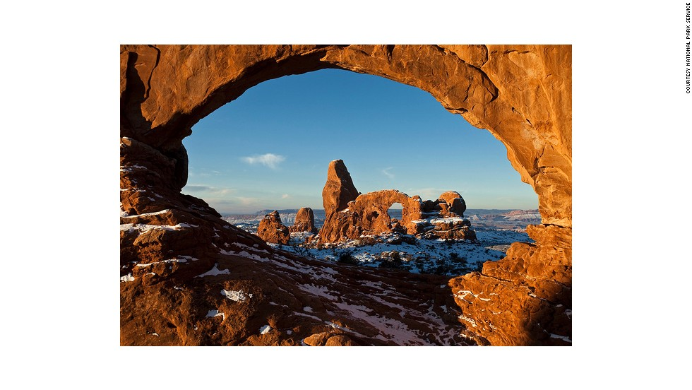 Turret Arch, seen here through North Window, is one of three giant arches on the Windows trail. North Window and South Window are arches known together as the Spectacles.
