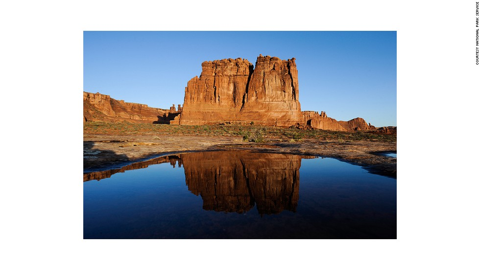 "<a href=""http://www.nps.gov/arch/naturescience/pools.htm"" target=""_blank"">Ephemeral Pools</a>, seen here in front of Organ rock, fill with rain water and are home to tiny ecosystems of plants and organisms."