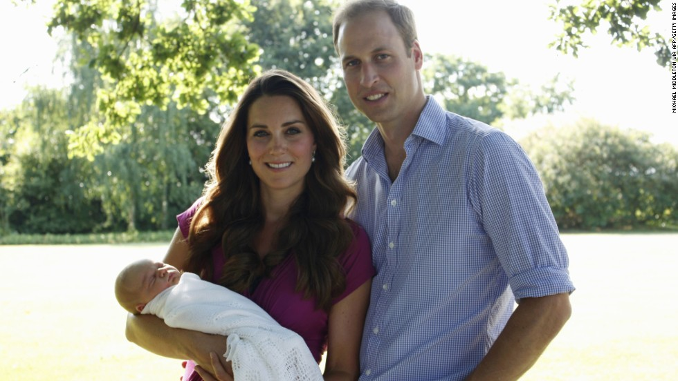 The couple poses with Prince George in early August at the Middleton family home in Bucklebury, England.