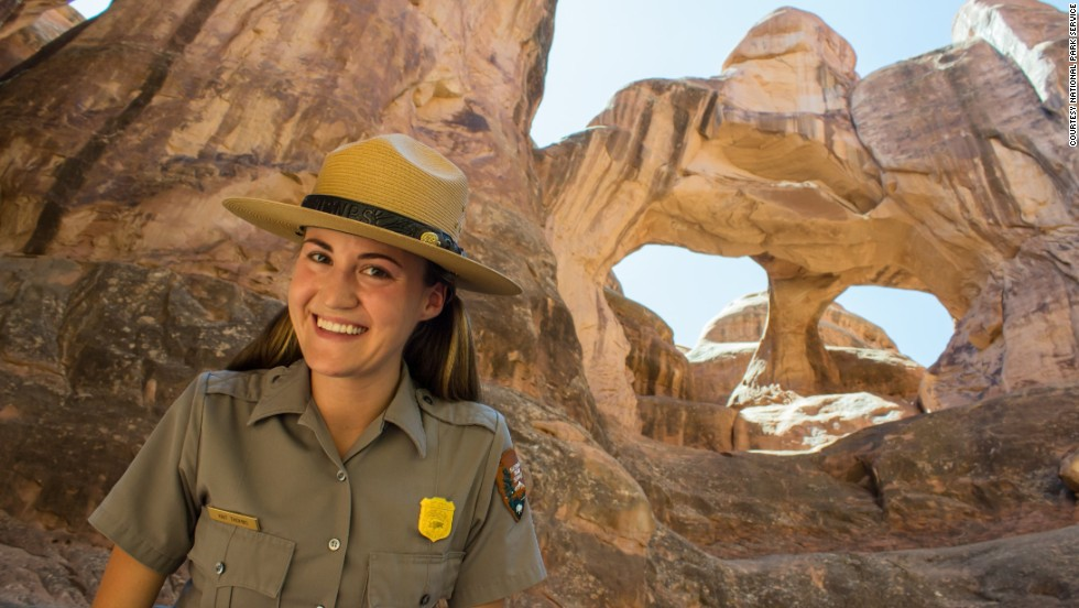 Kait Thomas, interpretative ranger at Arches National Park, stands in the Fiery Furnace below Twin Arches.