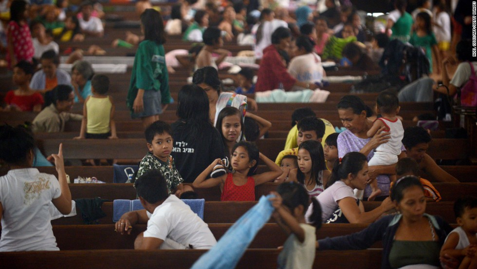 Flood victims take shelter in a church in Manila on August 20.