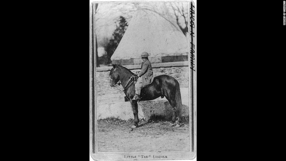 President Abraham Lincoln's son Tad rides one of his horses.