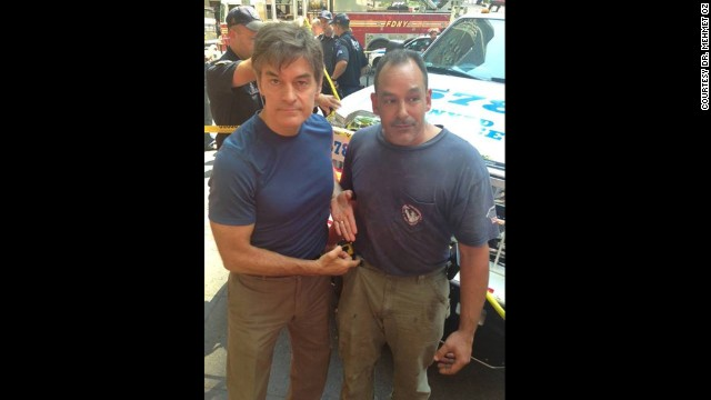 Dr. Mehmet Oz (l) and plumber David Justino (r) assisted at the scene of a car accident when a woman was hit by a taxi cab in New York City.