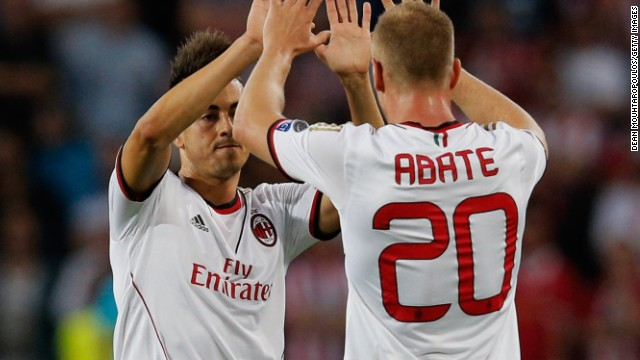 Stephan El Shaarawy celebrates scoring the crucial first goal for Milan teammate Ignazio Abate in the tie against PSV Eindhoven.