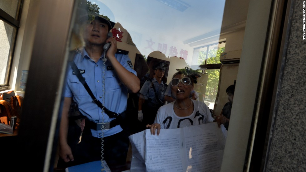 "AUGUST 21 - JINAN, CHINA: Police detain a demonstrator who was protesting against China's justice system outside a court in Jinan, where <a href=""http://cnn.com/2012/08/08/world/asia/china-bo-xilai-profile/index.html?iid=article_sidebar"">disgraced politician Bo Xilai</a> will soon go on trial. Once considered a rising star in China's Communist Party, he is at the center of one of the country's most closely watched <a href=""http://cnn.com/2013/08/18/world/asia/china-bo-xilai-trial-analysis/index.html?hpt=ias_t4"">political scandals</a>."