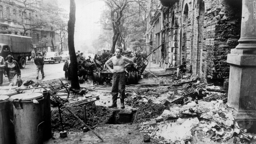 A file photo dated August 31, 1968 of a man standing amidst the damages caused by the confrontations between demonstrators and the Warsaw Pact troops and tanks in Prague. The troops and tanks entered Prague on August 21, 1968 to crush the new found freedom and re-establish a totalitarian regime.