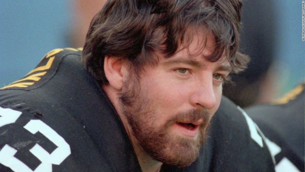 "The death of 36-year-old Pittsburgh Steelers offensive lineman Justin Strzelczyk put the link between football and CTE in the national spotlight. Strzelczyk was <a href=""http://www.nytimes.com/2007/06/15/sports/football/15brain.html"" target=""_blank"">killed in 2004</a> in a car crash after a 40-mile high-speed chase with police in New York."