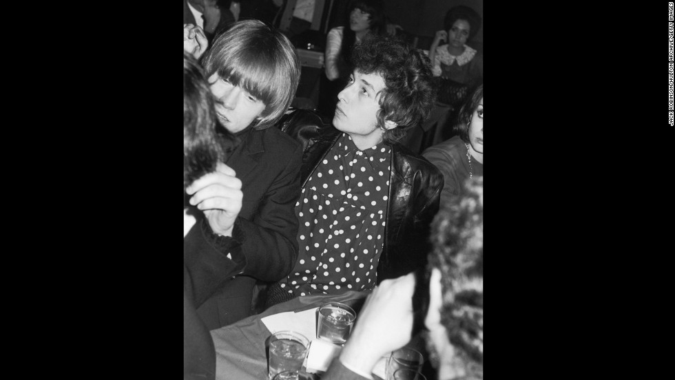 Brian Jones, left, from the Rolling Stones, and Bob Dylan attend a release party for a Young Rascals record, held by Bernstein at New York's Phone Booth nightclub in November 1965.