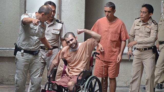 Saeid Moradi, 29, (center)  gestures to the media next to Mohammad Khazaei, 43, ahead of their sentencing.