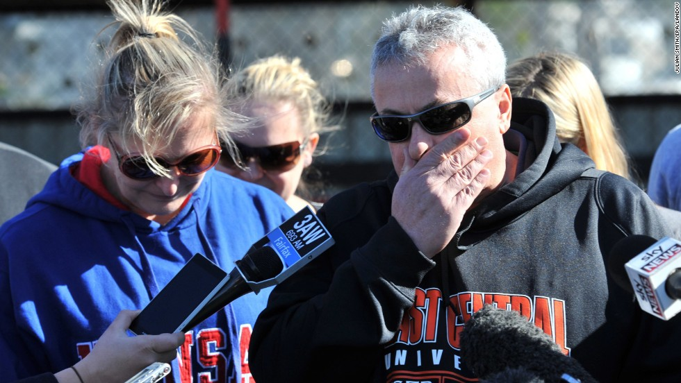 The parents of Christopher Lane, Peter and Donna, speak to the media in Melbourne on Monday, August 19.