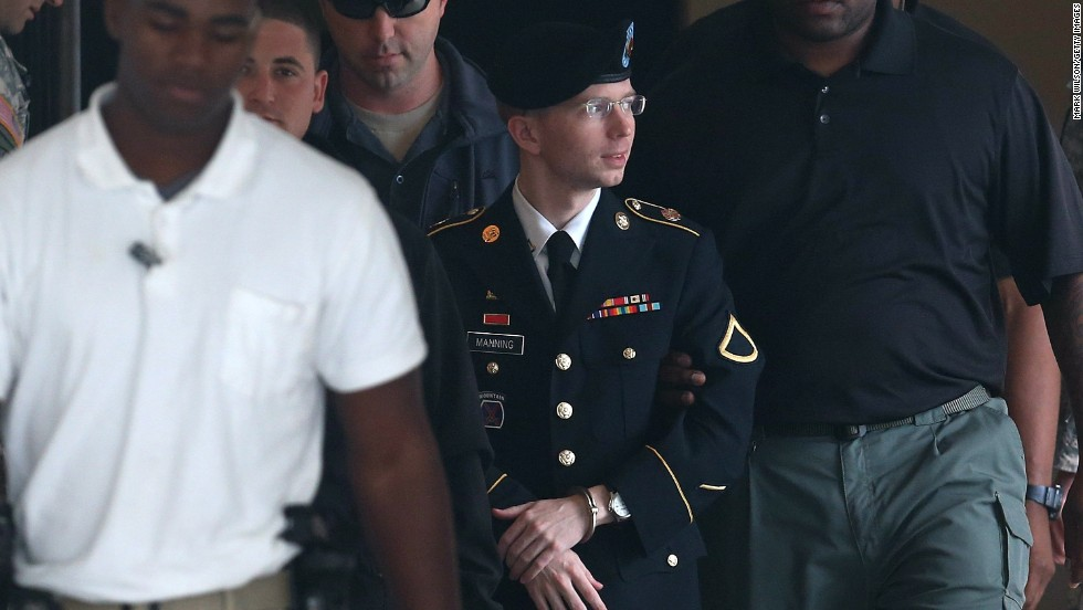 """In a statement read by his attorney at his sentencing, Manning said he acted """"out of love for my country and a sense of duty."""" That statement was part of Manning's application for a pardon from President Barack Obama. Here, Manning is escorted out during the sentencing phase of his trial on August 20 at Fort Meade."""