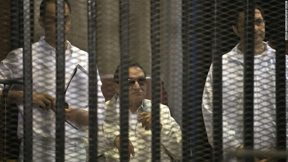 Mubarak and his sons Gamal, left, and Alaa are seen behind the defendants' cage during their retrial at the Police Academy in Cairo. Mubarak was granted a retrial. Later, a court ordered Mubarak be freed, pending his retrial.