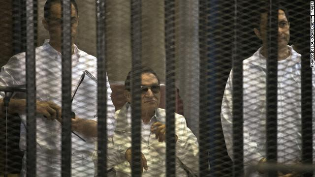 Mubarak and his two sons Gamal, left, and Alaa are seen behind the defendants' cage during their retrial at the Police Academy in Cairo on June 8.