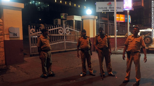 Policemen stand at the entrance gate to the city hospital where a gang rape victim is admitted, in Mumbai early morning on August 23, 2013. Five men gang-raped a woman photographer in India's financial hub Mumbai, police said August 23, stirring memories of a similar incident eight months ago in New Delhi which triggered nationwide protests. AFP PHOTO/Indranil MUKHERJEE (Photo credit should read INDRANIL MUKHERJEE/AFP/Getty Images)