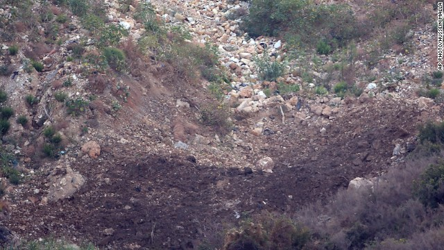 A crater made by an Israeli missile in front of a Popular Front for the Liberation of Palestine base on Friday.