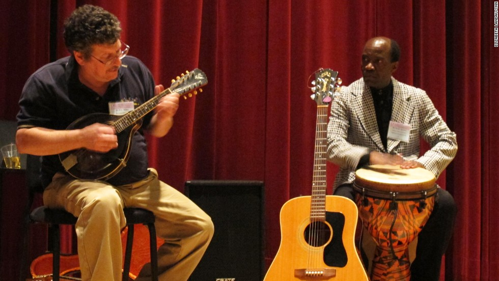 Music therapist Eric Miller performs with David Akombo, assistant professor of music education at Jackson State University, at the conference. Miller also demonstrated how biofeedback can be used in music therapy sessions.