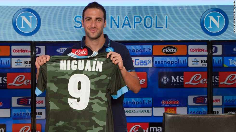 Napoli has invested heavily in new players during the transfer window in the hope it can launch a serious title challenge. Striker Gonzalo Higuain, seen here holding the club's new camouflage away kit, was signed from Real Madrid. Experienced manager Rafael Benitez, a European Champions League winner with Liverpool in 2005, has also been brought in as coach.