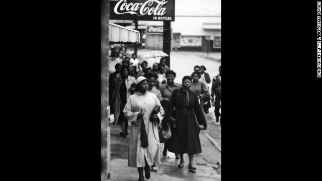 African American women walk along the sidewalk during a bus boycott, Montgomery, Alabama, February 1956.