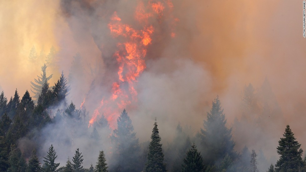 Smoke and flame blot out the horizon as the Rim Fire approaches Yosemite Lake near Groveland, California on Friday, August 23.