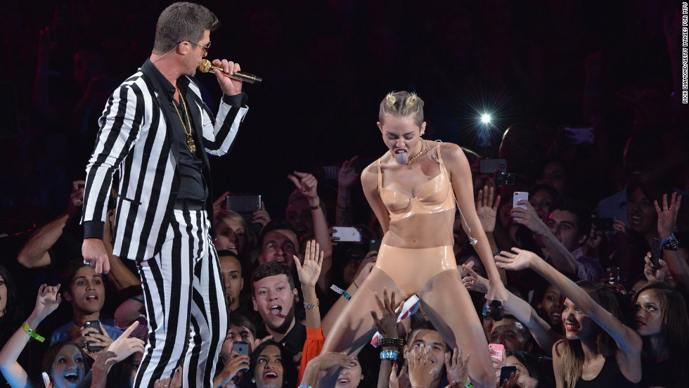 Cyrus shows off her moves with Robin Thicke during the 2013 MTV Video Music Awards in Brooklyn, New York, on Sunday, August 25.