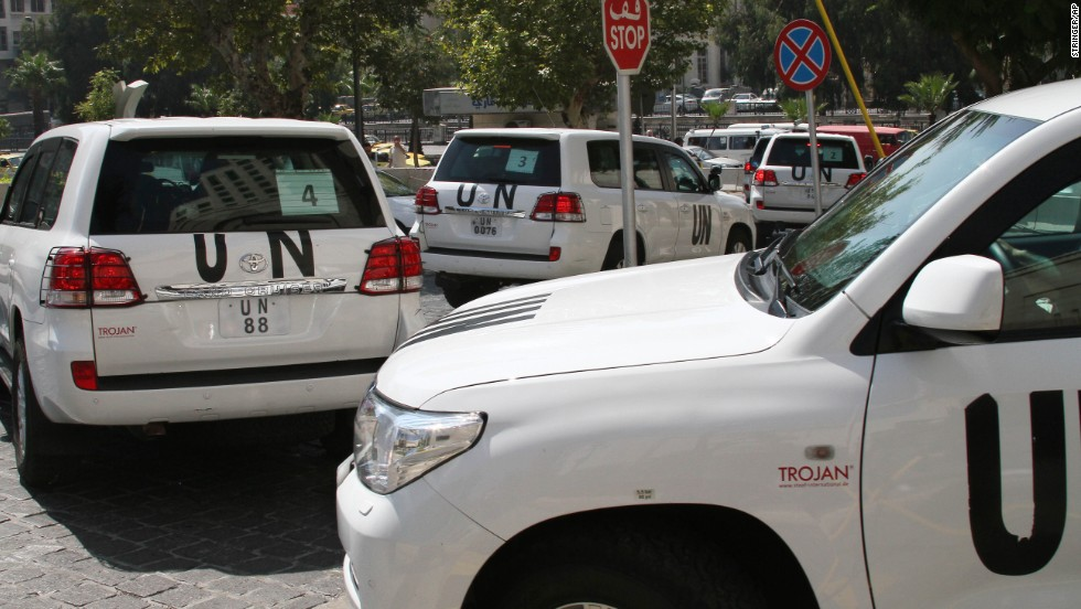 A U.N. team leaves its Damascus, Syria, hotel in a convoy on Monday, August 26. The team was to investigate an alleged chemical attack that killed hundreds last week in a suburb of the Syrian capital. Sniper fire hit a vehicle used by the U.N. chemical weapons investigation team multiple times Monday, according to the United Nations.