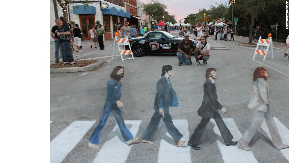 Artists Hector Diaz, left, and Ken Mullen overlook their recreation of the Beatles' Abbey Road album cover in Lake Worth, Florida.