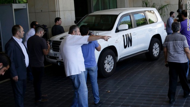 Media cover the arrival of the United Nations high representative for disarmament affairs, Angela Kane, at a hotel in Damascus, Syria, Saturday, Aug. 24, 2013. The United Nations disarmament chief arrived today to press President Bashar Assad's regime to allow U.N. experts to investigate an alleged chemical weapons attack this week that reportedly killed more than 130 people. Kane who was dispatched by the U.N. secretary-general to push for a speedy investigation into Wednesday's purported attack outside the Syrian capital, did not speak to reporters upon her arrival in Damascus. (AP Photo/Hassan Ammar)